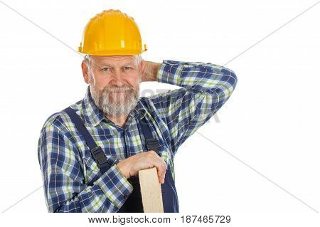 Picture of a tired male engineer posing with a yellow helmet holding a lath on isolated background