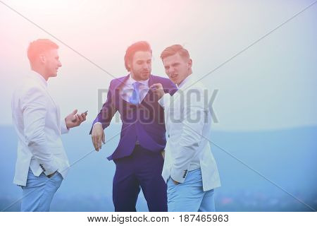 communication group of business people in formal outfit fighting on blue sky background businessman and twin men with phone outdoor business conflict conflict of interest pressure raidership