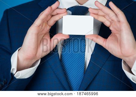Blank Business Card In Hands Of Man Or Executive