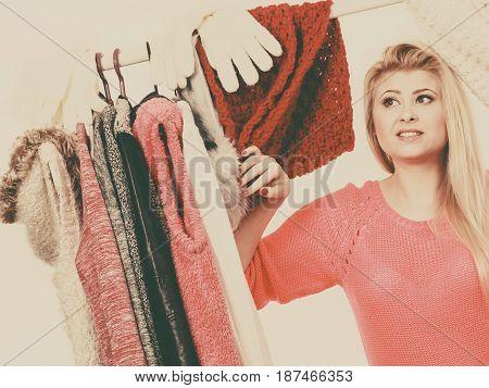 Woman In Home Closet Choosing Clothing