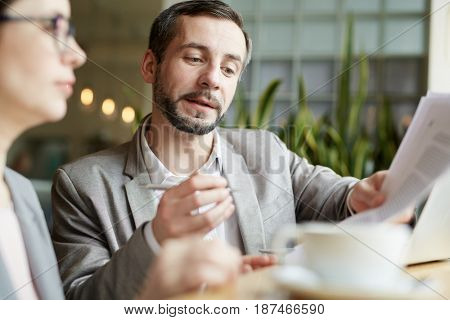 Confident employer explaining details of contract to woman
