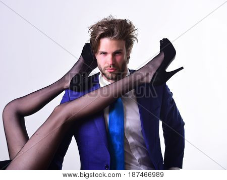 Handsome Man Or Businessman In Suit And Female Sexy Legs