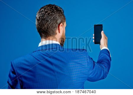 Handsome Man With Phone In Hand, New Technology And Communication