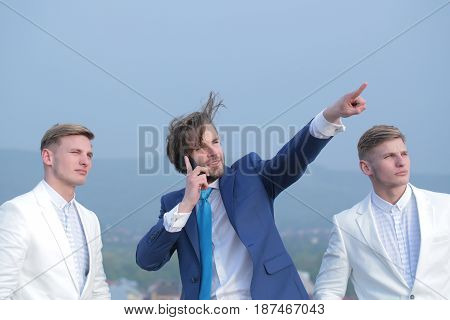 Man Speaking On Phone Pointing On Blue Sky, Business People