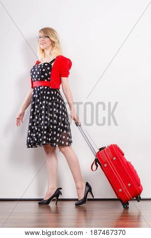 Elegant Fashion Woman With Red Suitcase