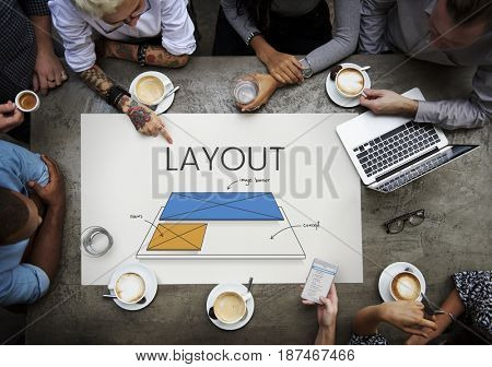 Workers working on billboard network graphic overlay on table