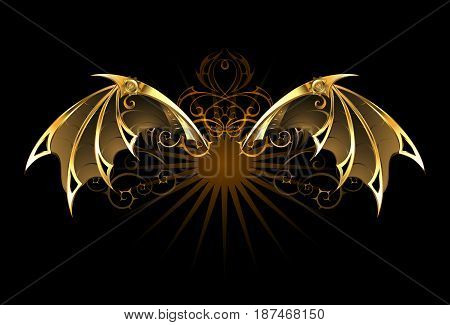 Mechanical dragon wings of gold and brass on a black background. Dragon Wings. Steampunk style.