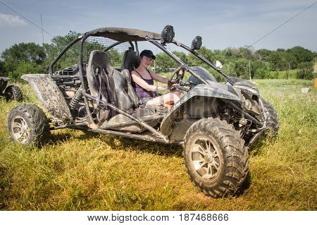 Buggy Car At Green Field. Young Woman Driving, Almaty, Kazakhstan