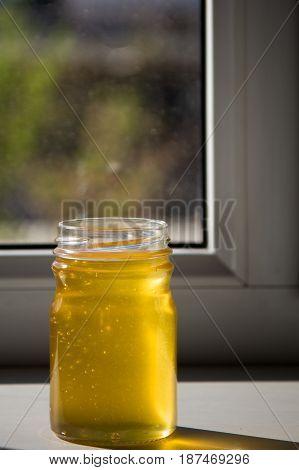 Organic Pure Honey In Jar On Window Sill