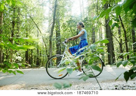 Sporty girl riding bicycle in park