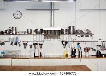 Empty kitchen with steel utensils and supplies