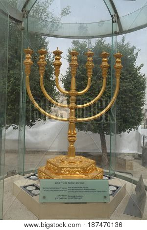 JERUSALEM, ISRAEL - APRIL 30, 2017: The golden menorah located in the Jewish Quarter in the Old City of Jerusalem. It is over two meters in height and plated with 43 kg (95 lbs) of gold