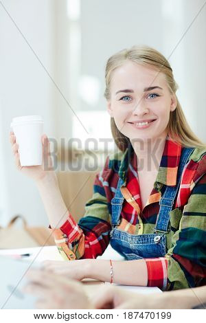 Pretty girl with drink looking at camera