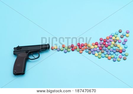 Pistol shooting sweets, applique artwork, shot from a gun aroma colored candies and jelly beans