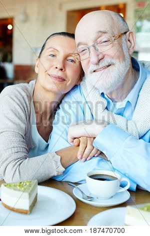 Romantic seniors enjoying one another in cafe