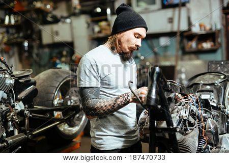 Self-employed repairman working in garage
