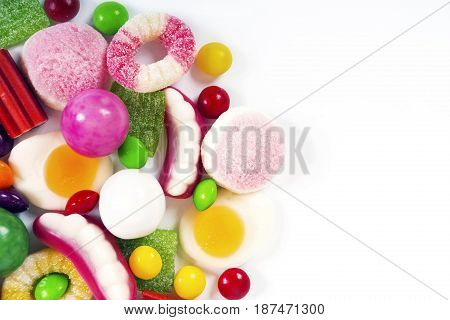 Colorful candies jelly and marmalade on white background. Top view with copy space