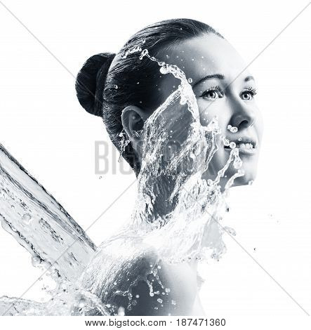 Beautiful young woman in splashes of water isolated on white. Cleansing and moisturizing concept.