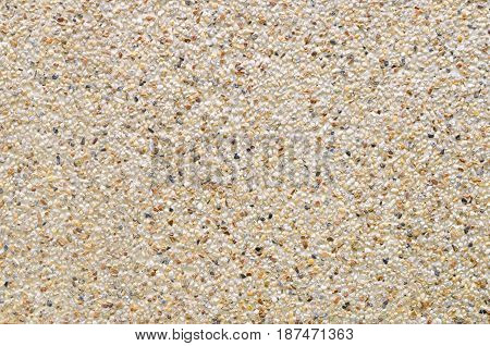 Close up gravel wall pattern Cement mixed small gravel stone wall or floor texture background abstract dense splash texture. random pebble gravel oval elements seamless pattern.