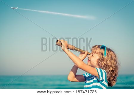 Happy Kid Playing Outdoor Against Sea And Sky