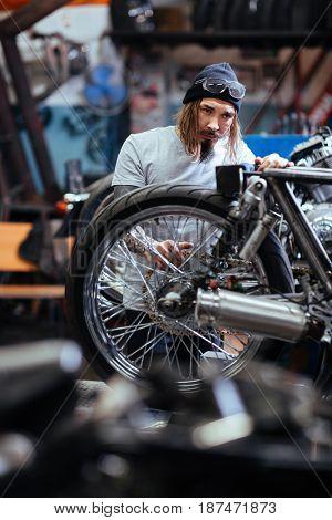 Young repairman or technician working in garage