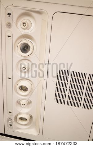 Interior Of Airplane Seat With Ceiling Button stock photo