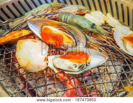 Grilling seafood on on the stove, Close up image