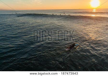Surfer Paddling Overhead Dawn Horizon Ocean