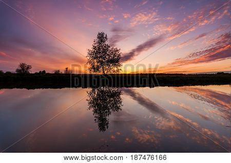 Reflection of a beautiful dawn sky in a river.