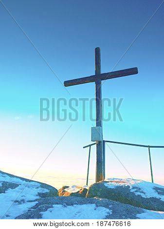 Sharp Summit  With Modest Cross Raised  On Mountain Peak.