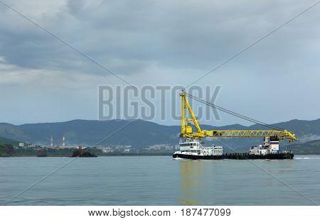 Petropavlovsk-Kamchatsky, Russia - August 15, 2016: New self-propelled floating crane SPK-43150 in the Pacific Ocean.
