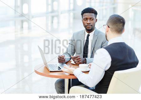 Small group of multi-ethnic businessmen having talk