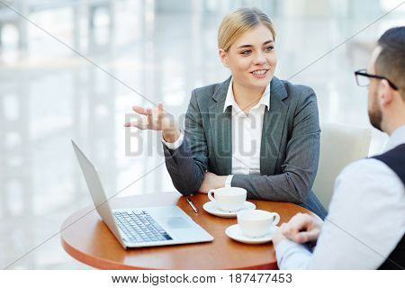 Businesswoman presenting financial information to her colleague