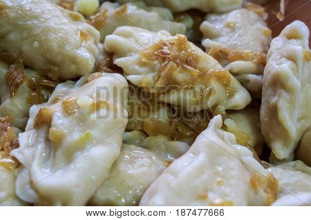 Closeup of traditional Russian dumplings with fried onion