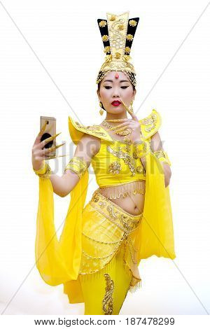 beautiful asian woman in a traditional chinese yellow dress making selfie isolated on white background