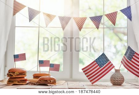 Patriotic holiday. USA are celebrate 4th of July. Top view with American flag on the table.