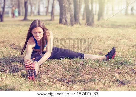 young woman warming up before a run.a healthy way of life. sports fitness.