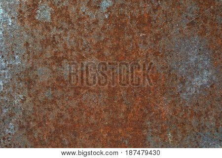 Grungy and rusty steel metal wall with heavy corrosion background texture
