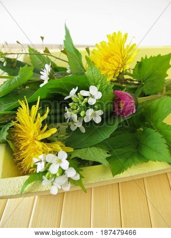Bouquet of wild herbs on the tray