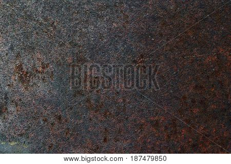 Rusty steel metal wall with heavy corrosion background pattern
