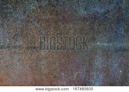 Ferruginous steel metal wall with heavy corrosion background texture