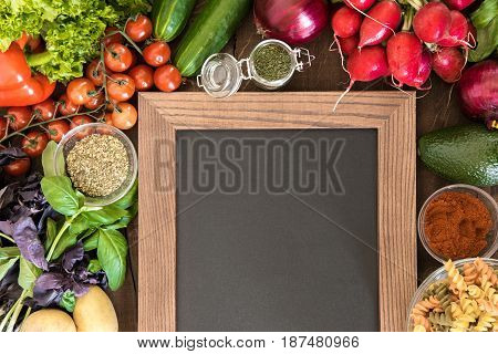 Blank Chalkboard With Set Of Ingredients And Spices For Cooking Italian Pasta From Above View. Food