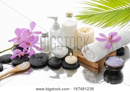Spa setting with orchid ,towel, palm