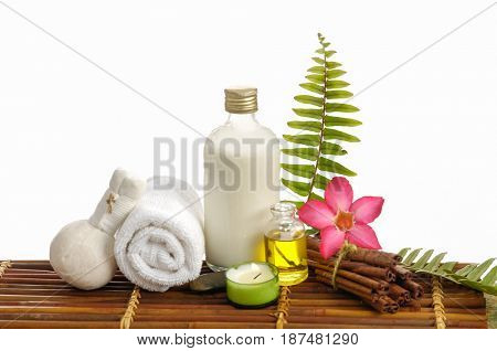 spa setting on mat background with pink orchid, towel