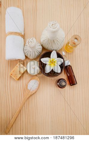 Spa treatment with salt in spoon ,ball ,towel,on wooden board background