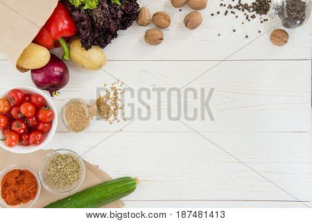Top View Of Fresh Raw Vegetables And Spices On Wooden Table