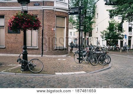 Utrecht Netherlands - August 4 2016: People and bicycles in street in historic centre of Utrecht the Netherlands