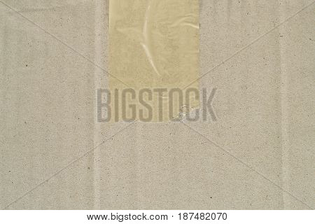 close-up brown cardboard with sticky tape texture background