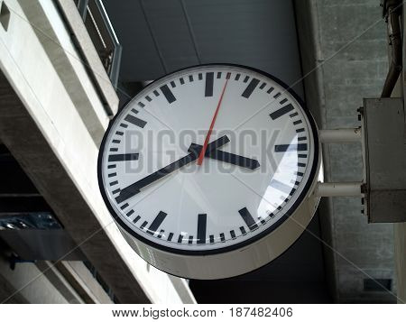 electronics clock on pole of train station, equipment for check time when traveling in the city