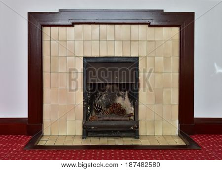 Spectacle of indoor wall, fireplace and floor carpet